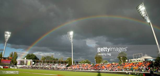 Rainbow is seen as rain delays play during the Big Bash League match between the Sydney Thunder and the Hobart Hurricanes at Manuka Oval on February...