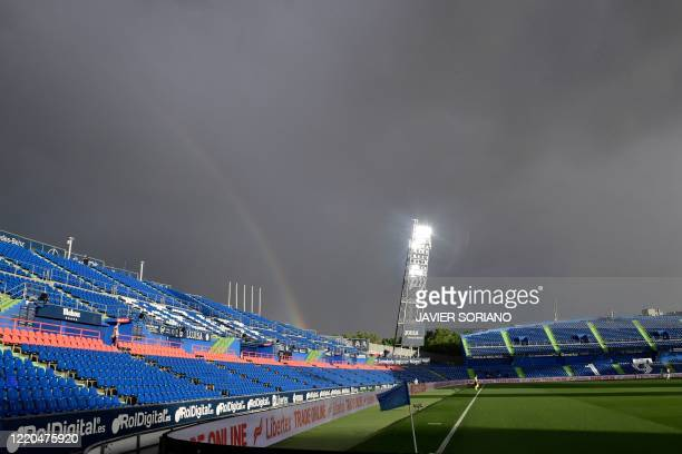 A rainbow is seen during the Spanish league football match Getafe CF against RCD Espanyol at the Coliseum Alfonso Perez stadium in Getafe on June 16...
