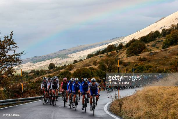 Rainbow is seen in the sky as the pack of riders climb during the 9th stage of the Giro d'Italia 2020 cycling race, a 208-kilometer route between San...