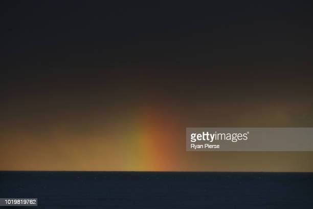 A rainbow is seen of the coast of Sydney on August 19 2018 in Sydney Australia