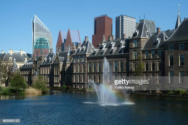 A rainbow is seen on a fountain of the Hofvijver or 'Court Pond' in front of Binnenhof on May 3 in The Hague Netherlands