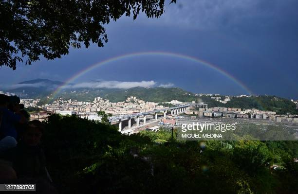 Rainbow is seen over the new San Giorgio bridge on the inauguration day on August 3 , 2020 in Genoa, the new high-tech structure will have four...