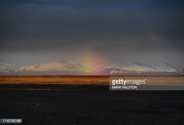 A rainbow is seen over the permafrost in the town of Quinhagak on the Yukon Delta Alaska on April 12 2019