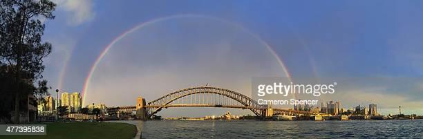 A rainbow is seen over the Sydney Harbour Bridge on June 17 2015 in Sydney Australia