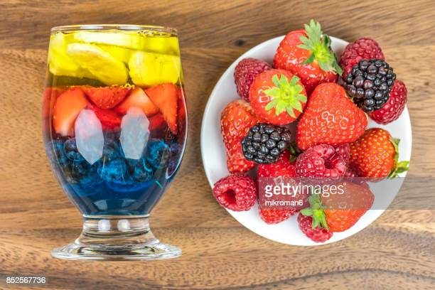 Rainbow Jello with strawberry's, blueberry, banana and pear with fresh berry fruits, homemade dessert