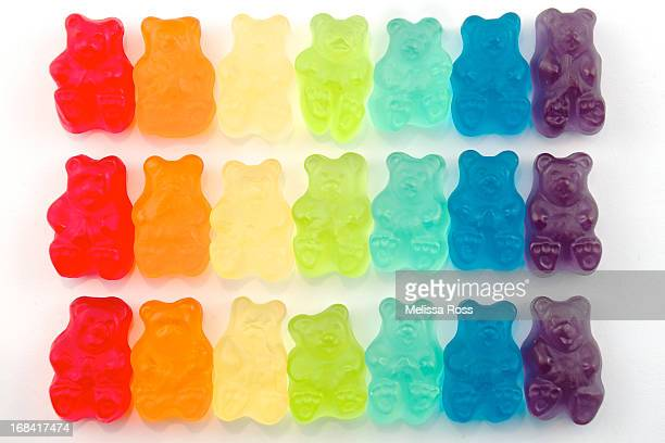 rainbow jelly bear candy - gummi bears stock photos and pictures