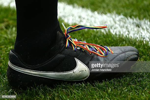 Rainbow laces are seen on officlas boots during the Premier League match between Watford and Stoke City at Vicarage Road on November 27 2016 in...