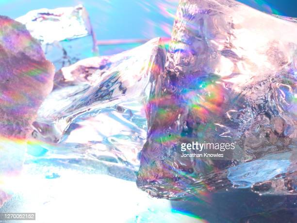 rainbow light on ice - ice stock pictures, royalty-free photos & images