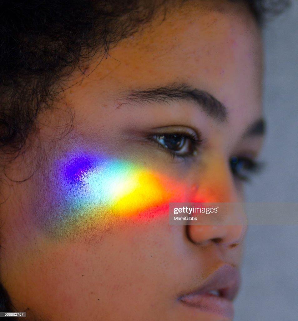 Rainbow light refract the face : Stock Photo