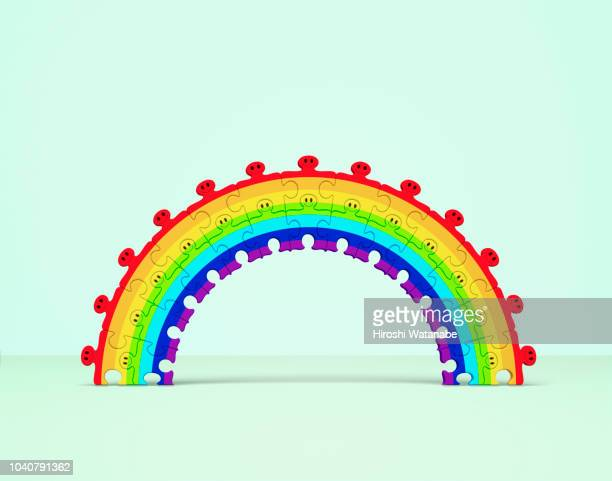 rainbow made of puzzle men - colors of rainbow in order stock pictures, royalty-free photos & images
