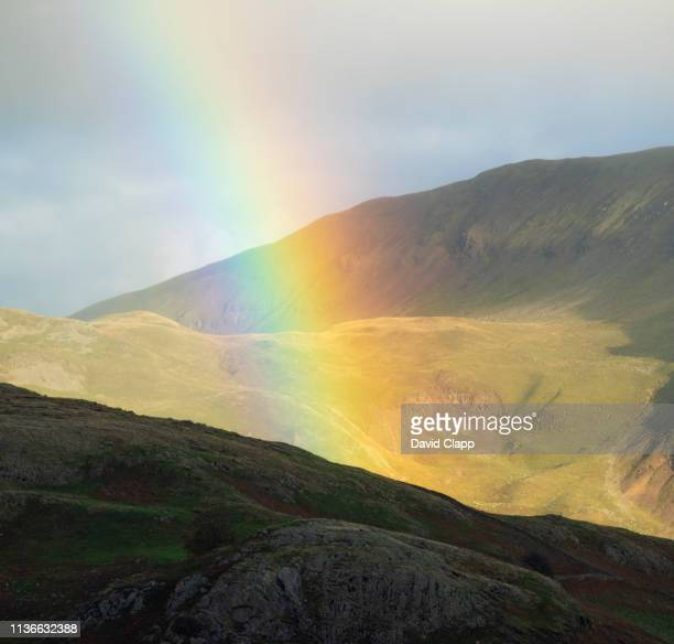 rainbow near castlerigg in the lake district, cumbria, united kingdom - idyllic stock pictures, royalty-free photos & images
