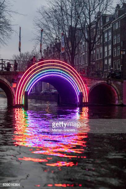 Rainbow neonlight archway on Bridge during Amsterdam Light Festival