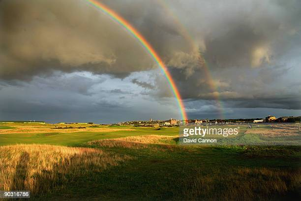 Rainbow on a very stormy evening behind the green on the par 4, 15th hole 'Cartgate ' which shares it's green with the 3rd hole and is protected by...