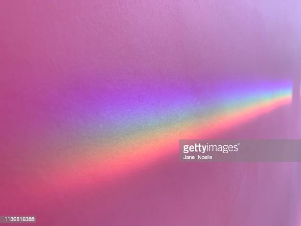 rainbow on pink wall - spectrum stock pictures, royalty-free photos & images
