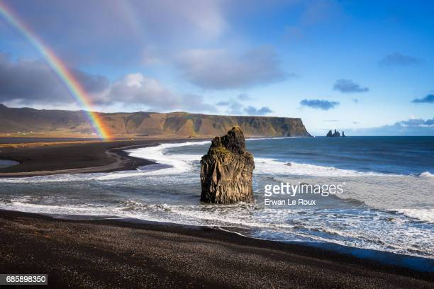 rainbow on reynisfjara beach - marée stock pictures, royalty-free photos & images