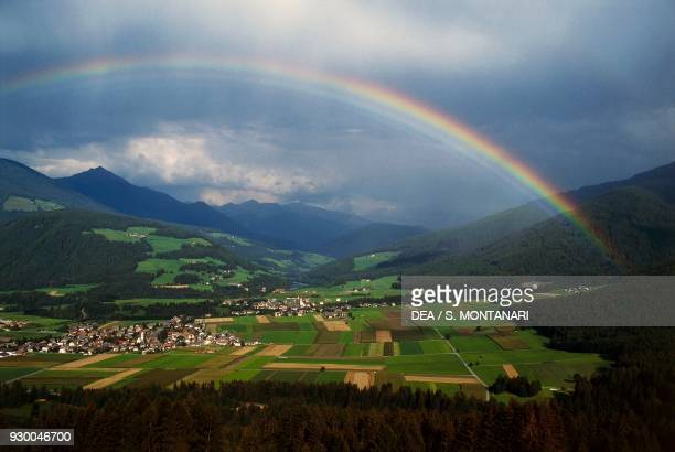 Rainbow on the villages of Valdaora-Olang, Puster Valley, Trentino-Alto Adige, Italy.