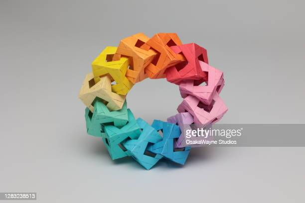 rainbow origami circle - shape stock pictures, royalty-free photos & images