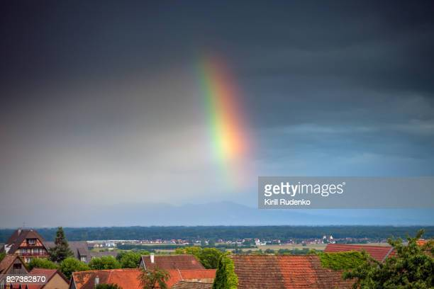 Rainbow over a village in Alsace, France