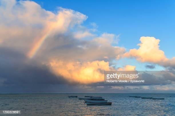 rainbow over boats in the tropical lagoon, le morne brabant, mauritius - インド洋 ストックフォトと画像