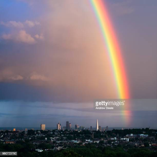 rainbow over city, london, uk - rainbow stock pictures, royalty-free photos & images