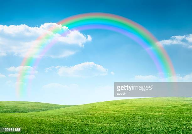 rainbow over idyllic hilly landscape - rainbow stock pictures, royalty-free photos & images