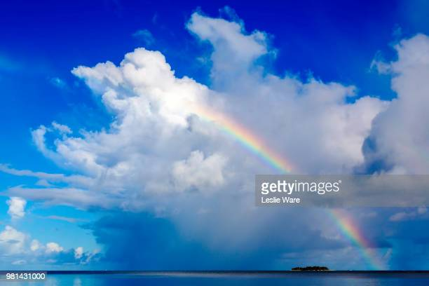 rainbow over island, managaha island, northern mariana islands - 虹 ストックフォトと画像