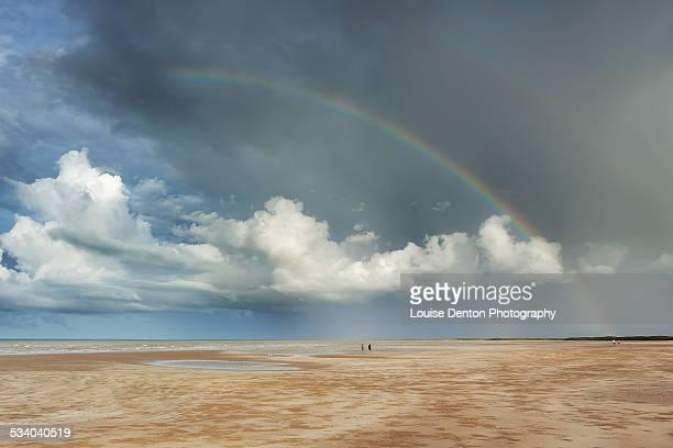Rainbow over Lee Point Beach walkers