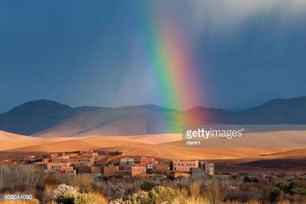 rainbow over morocco village in desert - merzouga stock pictures, royalty-free photos & images