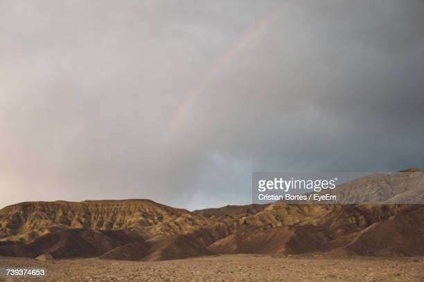 rainbow over mountain against sky - bortes fotografías e imágenes de stock