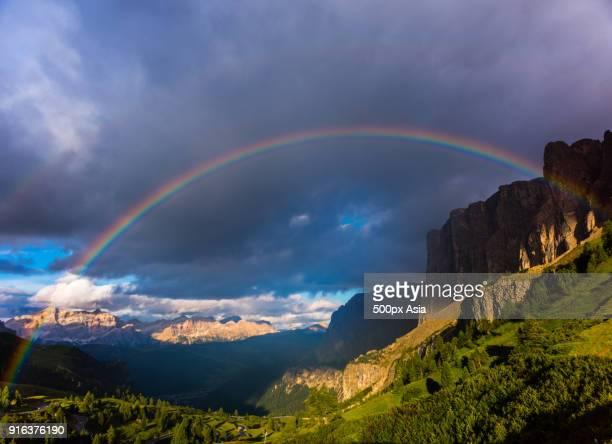 rainbow over mountain forest, italy - image foto e immagini stock
