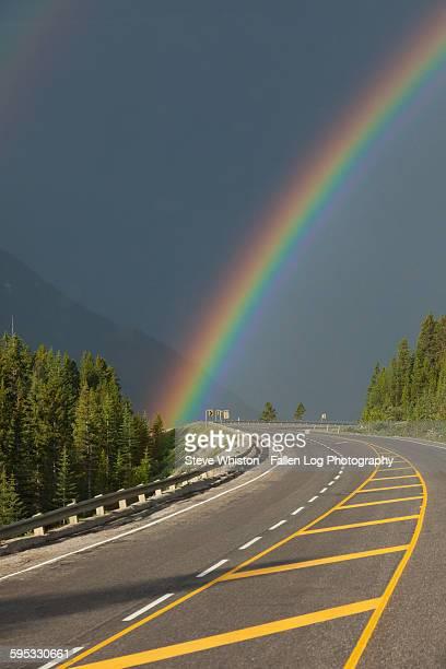 Rainbow over mountain highway