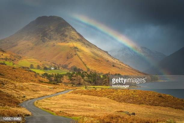 rainbow over mountain peaks wast water yewbarrow lake district uk - english lake district stock pictures, royalty-free photos & images