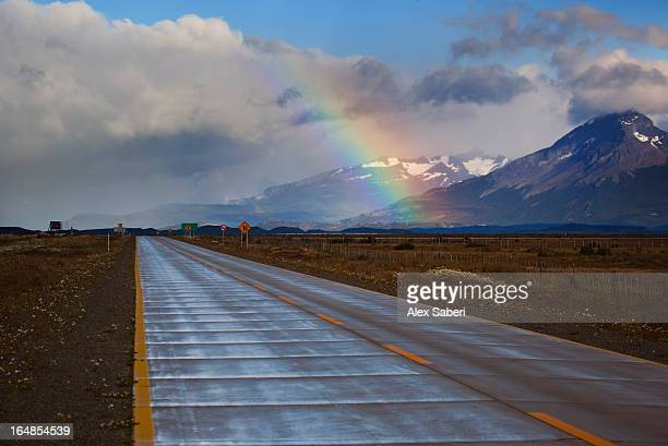 a rainbow over mountains on the way to puerto natales, chile. - alex saberi stock pictures, royalty-free photos & images