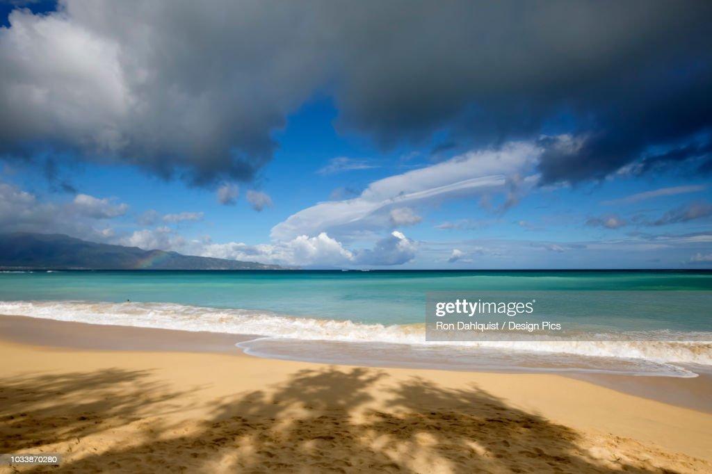 rainbow over ocean and baldwin beach on the north shore of maui