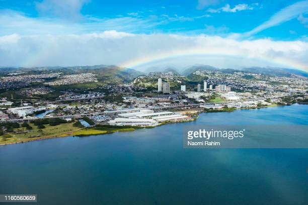rainbow over pearl harbor, waimalu shopping district, kamehameha hwy and mountains, honolulu, oahu, hawaii - hawaii islands stock pictures, royalty-free photos & images