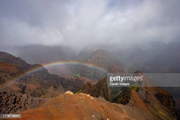 rainbow over red clay at waimea canyon, kauai - waimea canyon stock pictures, royalty-free photos & images