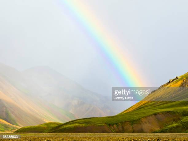 Rainbow over rural fields and hillside, Landmannalaugar, Fjallabak Nature Reserve, Iceland