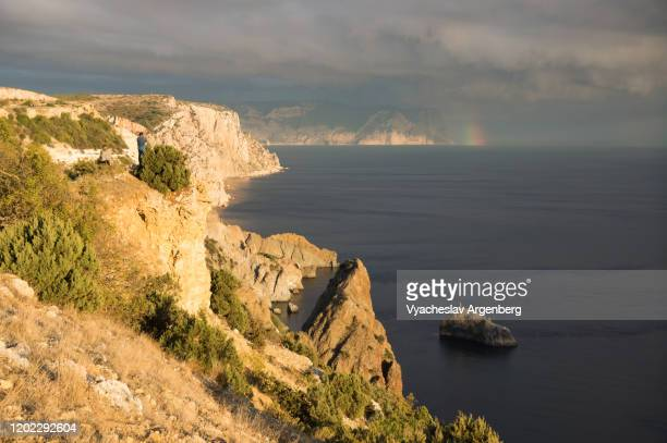 rainbow over sea coast, black sea, crimea - argenberg stock pictures, royalty-free photos & images