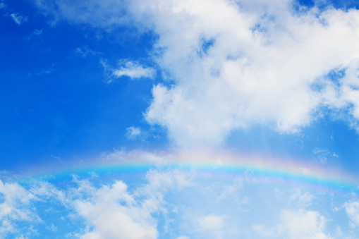Rainbow over the Blue sky and cloud - gettyimageskorea