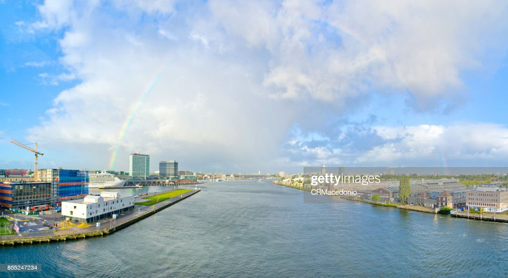 Rainbow over the city of Amsterdam. : Stock Photo
