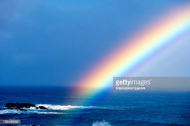 Rainbow over the pacific ocean near Oahu Hawaii USA