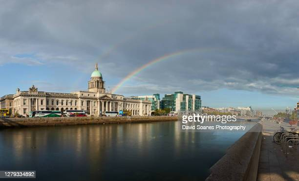 a rainbow over the quays along the river liffey in dublin city, ireland - david soanes stock pictures, royalty-free photos & images