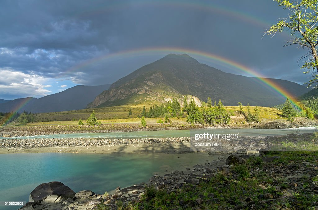 Rainbow over the river. Altai Mountains, Russia. : Stock Photo
