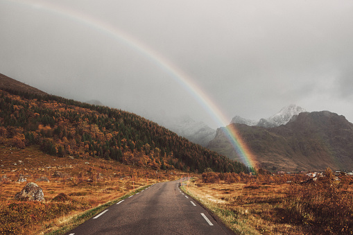 A rainbow over the road and mountains after the storm in Norway - gettyimageskorea