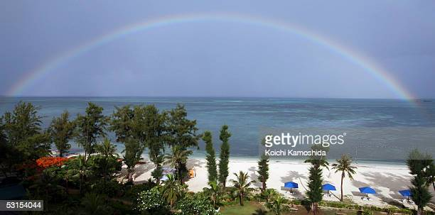 Rainbow over the sea is seen during Emperor Akihito and Empress Michiko's visit to their island on June 27, 2005 in Saipan, Northern Mariana Islands....
