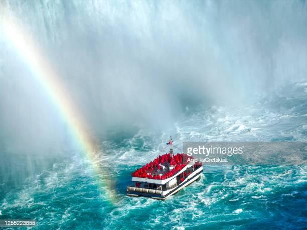 rainbow over tourist boat, niagara falls, ontario, canada - ontario canada stock pictures, royalty-free photos & images