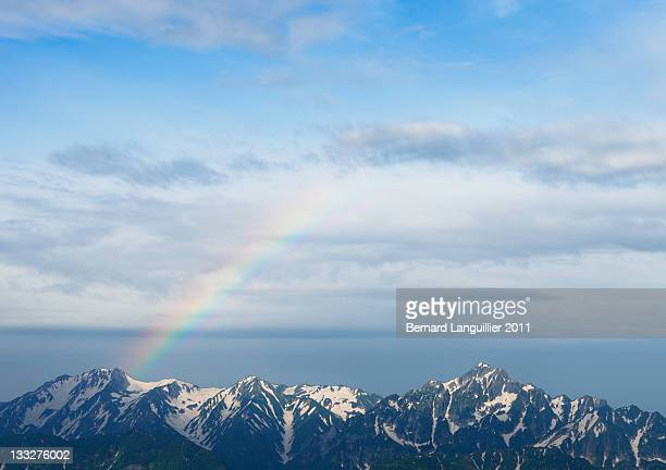 rainbow over tsurugidake in japanese alps - hokuriku region stock photos and pictures