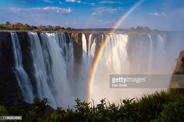 rainbow over victoria falls - don smith stock pictures, royalty-free photos & images