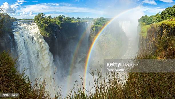 rainbow over victoria falls, zimbabwe, africa - victoria falls stock pictures, royalty-free photos & images