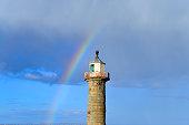 Rainbow over Whitby harbour East lighthouse